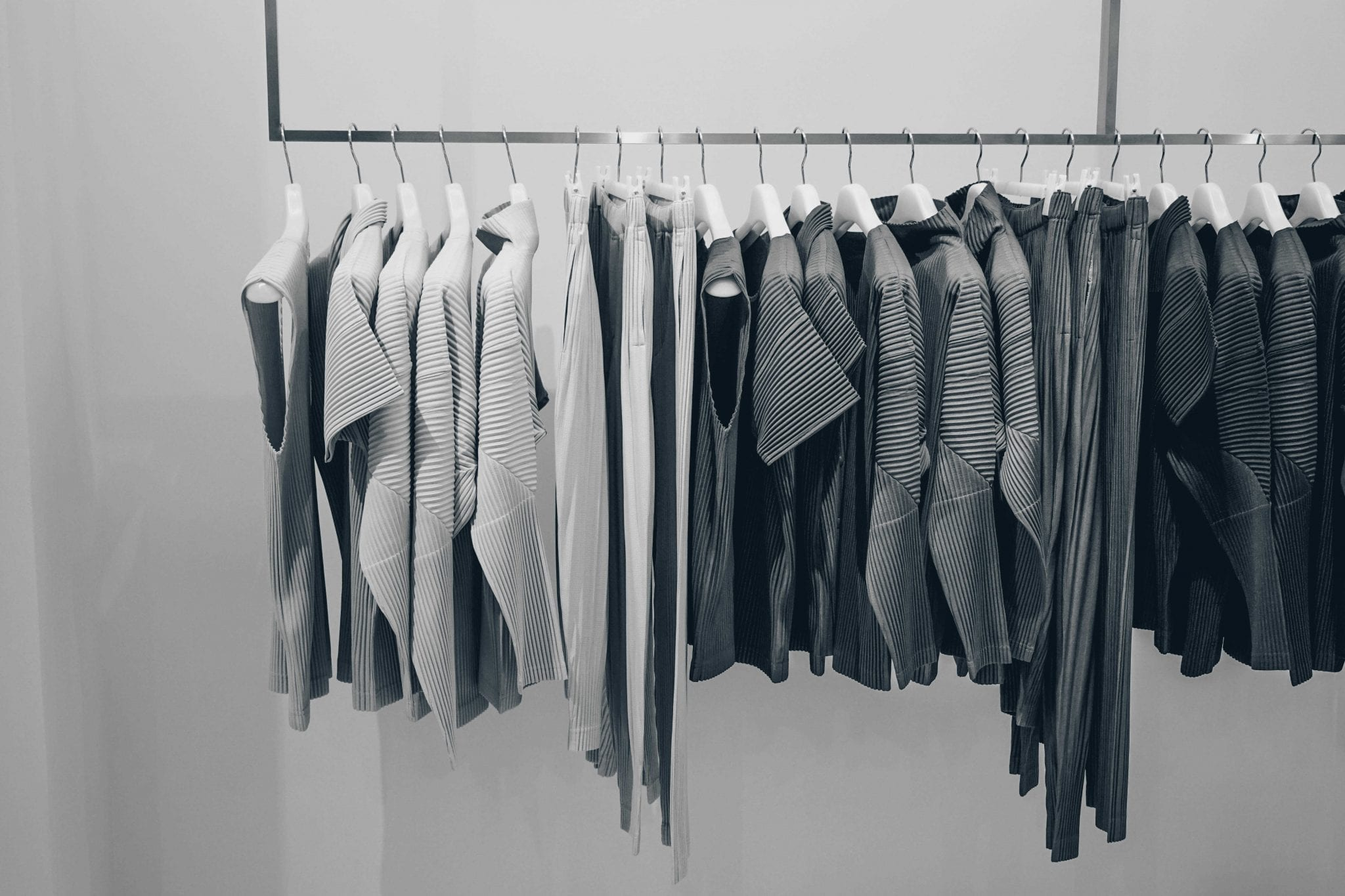 black and white picture of clothes hanging on a rack