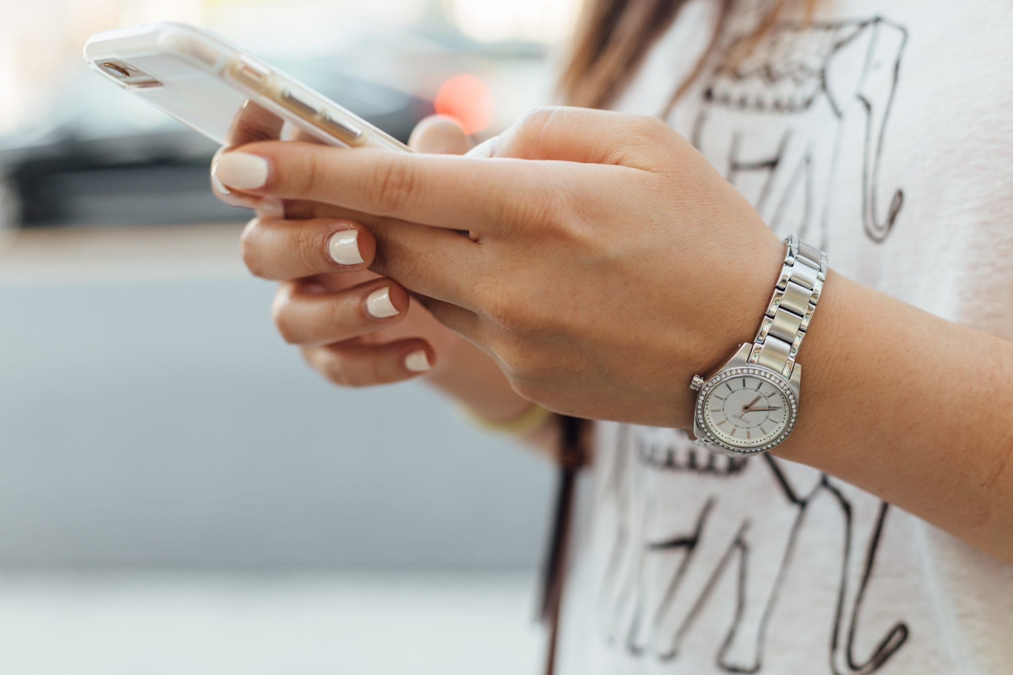 close up shot of hands holding phone