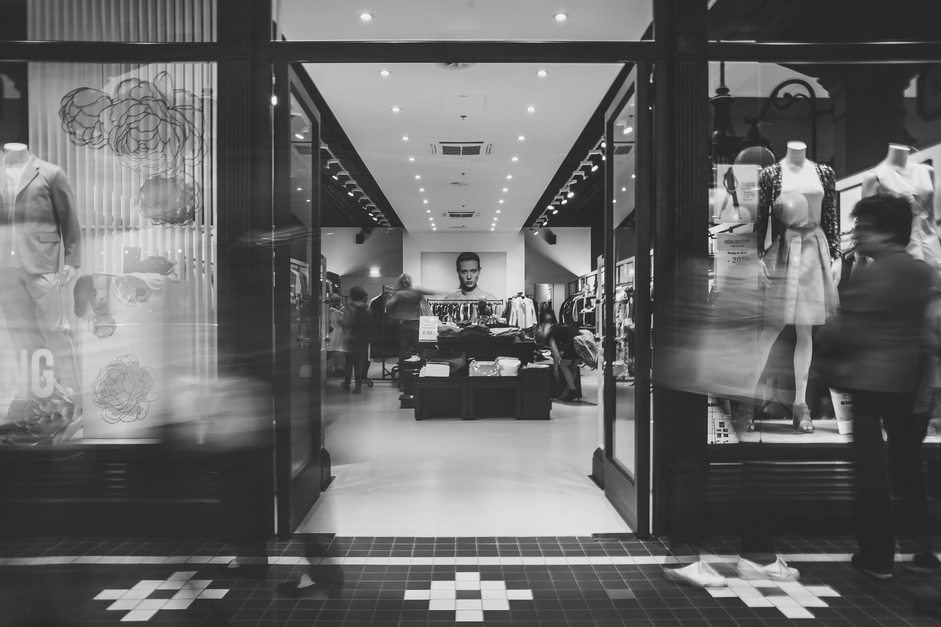 Storefront in black and white with shoppers