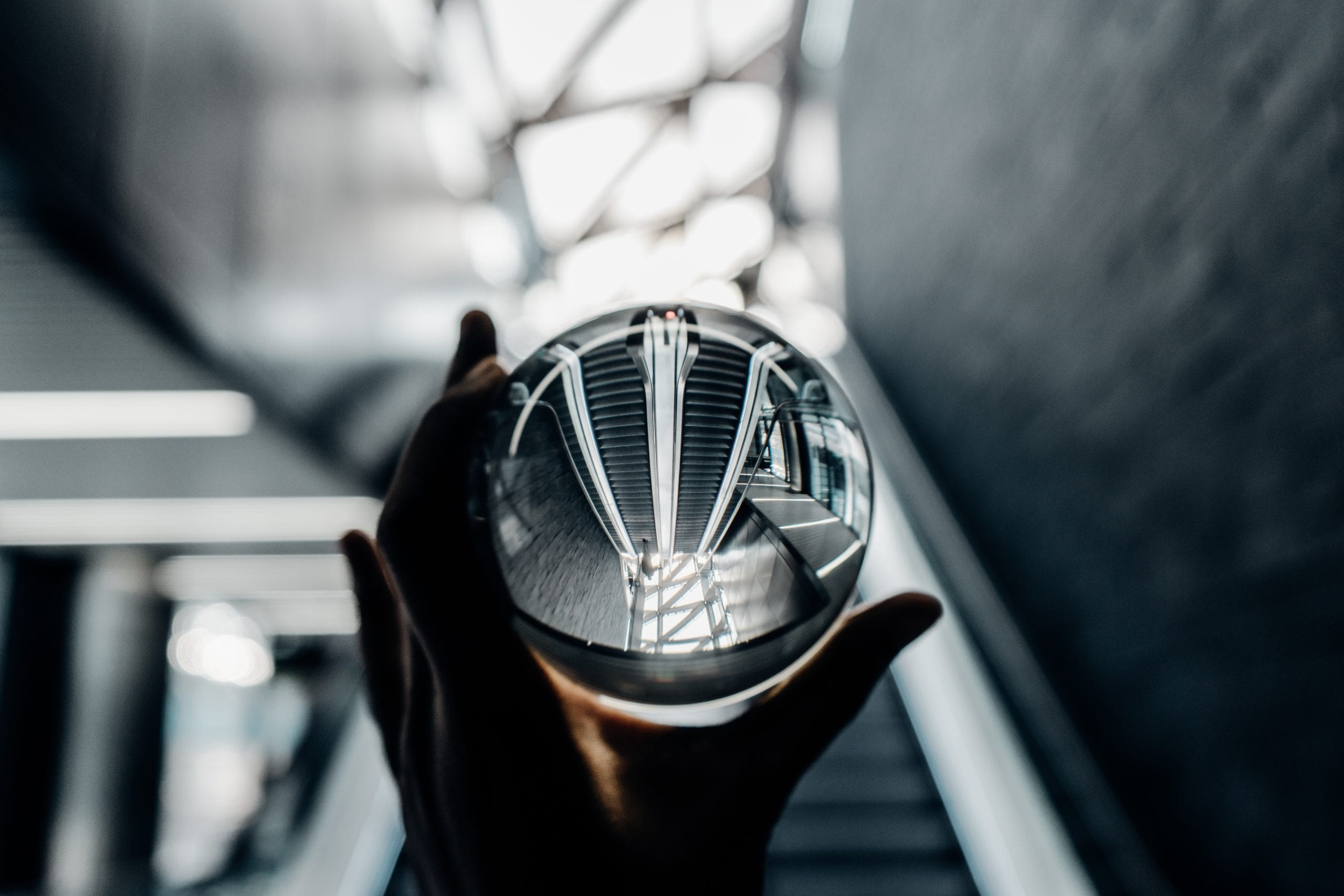 Retail 2020 Predictions symbolized by a hand holding a crystal ball