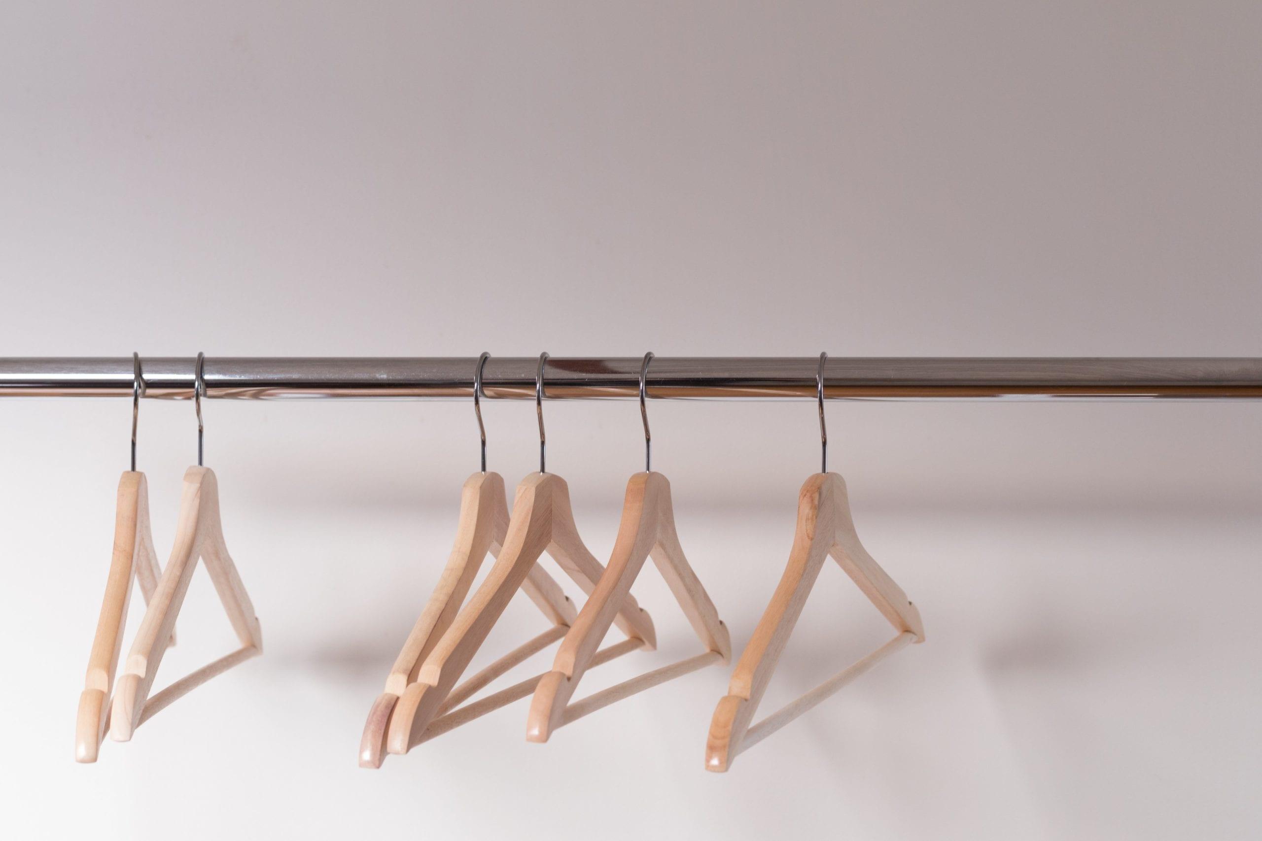 Empty wooden hangers on rack
