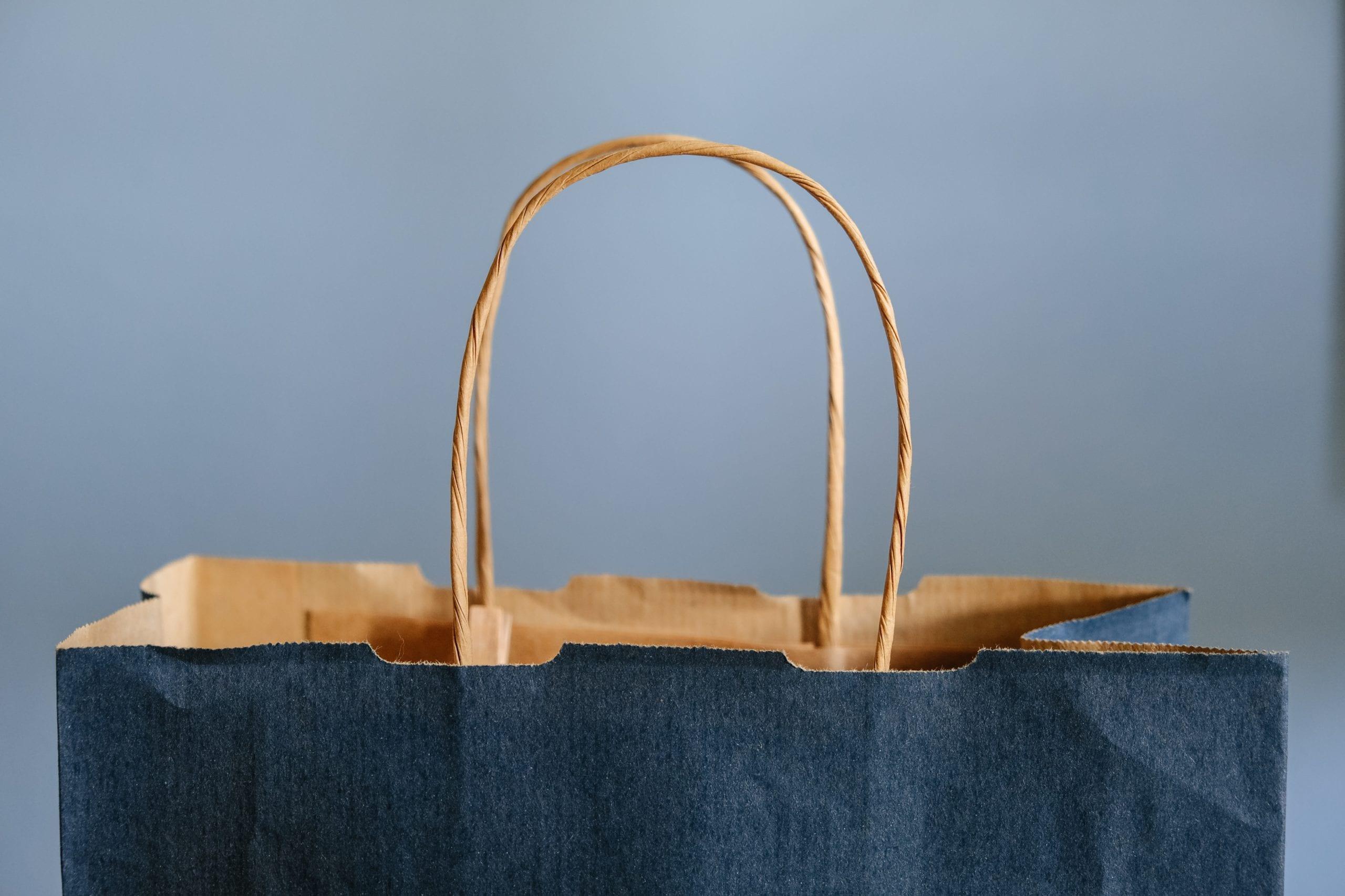 Close up shot of brown paper shopping bag