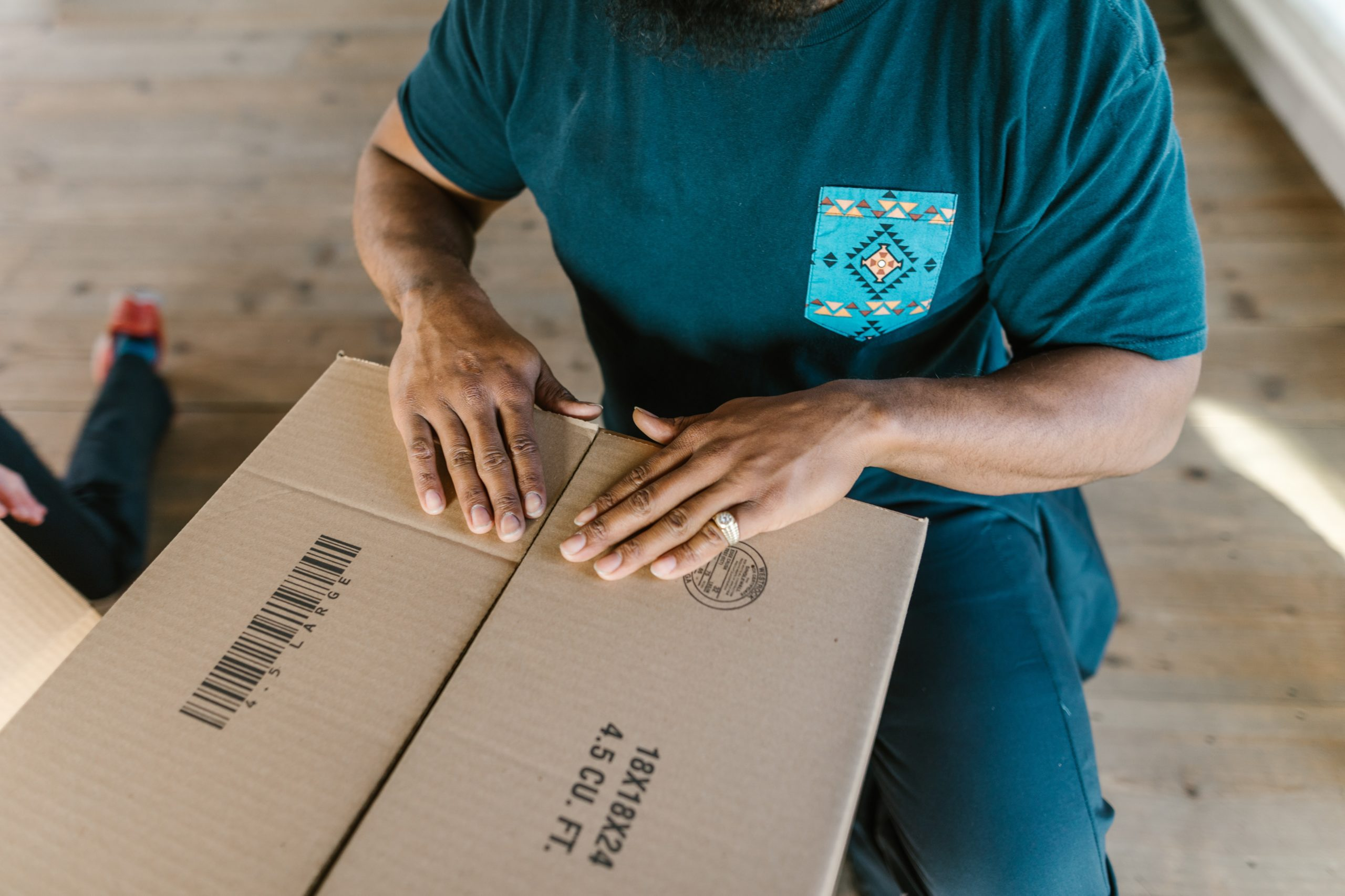 Man packing a brown box
