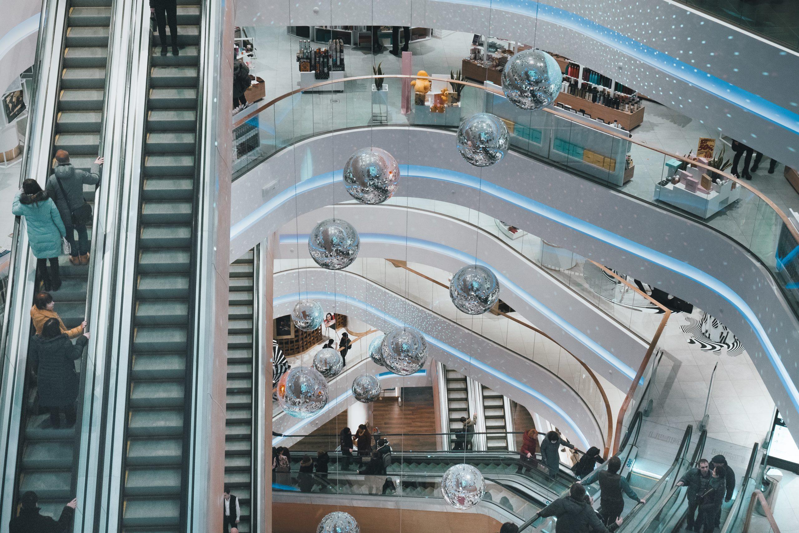 aerial view of escalators in a mall atrium